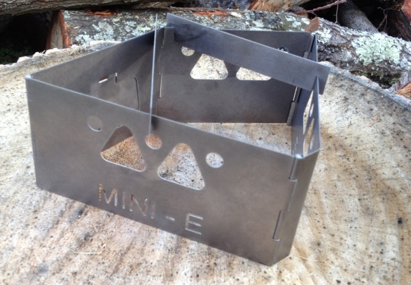 Mini-E camping stove folds up, out into different shapes